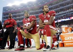 San Francisco 49ers safety Eric Reid (35) and quarterback Colin Kaepernick (7) kneel during the national anthem.