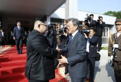 In this May 26, 2018, photo provided on May 27, 2018, by the North Korean government, North Korean leader Kim Jong Un, left, and South Korean President Moon Jae-in, right, shake hands after their meeting at the northern side of Panmunjom in North Korea.