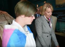Student Torin Hodgman, left, with Education Secretary Betsy DeVos, right.
