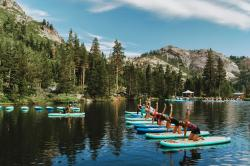 Participants work out on paddle boards during Wanderlust Squaw Valley 2017, in North Lake Tahoe, Calif.