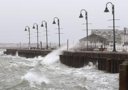 This March 2, 2018 file photo shows high Winds and rough surf pound the bulkhead in Stone Harbor, N.J.