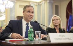 In this Wednesday, Nov. 1, 2017 photo provided by NASA, Rep. James Bridenstine, R-Okla., nominee for administrator of NASA, testifies at his nomination hearing before the Senate Committee on Commerce, Science, and Transportation in the Russell Senate Office Building in Washington