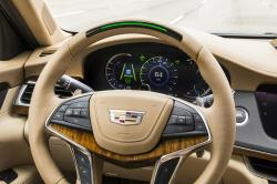 In this undated photo provided by General Motors a steering wheel light bar and cluster icons indicates an active status of Super Cruise in a Cadillac with the green light bar