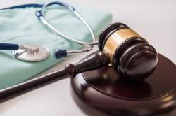 Justice Dept. Takes Aim at Heart of Health Law