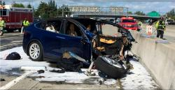 In this March 23, 2018, file photo provided by KTVU, emergency personnel work at the scene where a Tesla electric SUV crashed into a barrier on U.S. Highway 101 in Mountain View, Calif.