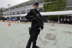 A police officer guards the entrance of the international media center Sunday, June 10, 2018, in Singapore ahead of the summit between U.S. President Donald Trump and North Korean leader Kim Jong Un on June 12