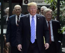 U.S. President Donald Trump leaves the G7 Leaders Summit in La Malbaie, Que., on Saturday, June 9, 2018., with White House Chief of Staff John Kelly, left, and National Security Adviser John Bolton