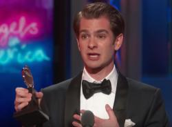 Andrew Garfield accepts the Tony Award.