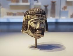 This Monday, June 4, 2018 photo shows a detailed figurine of a king's head on display at the Israel Museum, dating to biblical times, and found last year near Israel's northern border with Lebanon, in Jerusalem