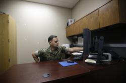 In this May 16, 2018 image, Marine Chief Warrant Officer David Coan, 35, works at his desk in Camp Pendleton, Calif.