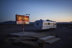 In this April 27, 2018, photo, a sign advertises the Love Ranch brothel in Crystal, Nev.