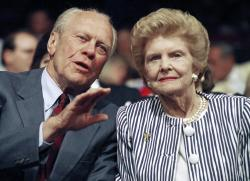 In this Aug. 19, 1992 file photo, former President Gerald R. Ford and his wife Betty Ford watch a session of the Republican National Convention in the Houston Astrodome