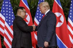 U.S. President Donald Trump shakes hands with North Korea leader Kim Jong Un at the Capella resort on Sentosa Island in Singapore.