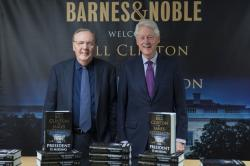 Former President Bill Clinton, right, and author James Patterson