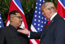U.S. President Donald Trump, right, meets with North Korean leader Kim Jong Un on Sentosa Island in Singapore.