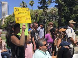 Opponents of a California bill to declare gay conversion therapy a fraudulent practice gather at a rally outside the Capitol as the Senate holds a hearing on the matter inside in Sacramento, Calif.