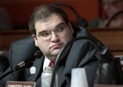 In this March 2, 2015, file photo, Wisconsin Republican state Rep. Andre Jacque is seen at a labor committee hearing at the State Capitol in Madison, Wis. Jacque faces Democrat Caleb Frostman in a special election in northeastern Wisconsin's 1st Senate District