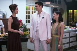 "From left, Michelle Yeoh, Henry Golding and Constance Wu in a scene from ""Crazy Rich Asians."""