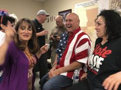 In this Tuesday, June 12, 2018 photo Nevada brothel owner Dennis Hof, second from right celebrates after winning the primary election in Pahrump, Nev.