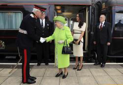 Britain's Queen Elizabeth II and Meghan, the Duchess of Sussex arrive by Royal Train at Runcorn Station, north west England.