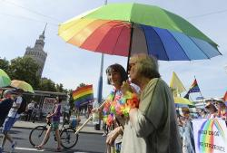 People take part in a Gay Pride parade in Warsaw, Poland.
