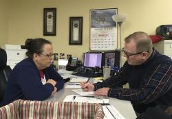 David Ermold, right, files to run for Rowan County Clerk in Kentucky as Clerk Kim Davis look on in Morehead, Ky
