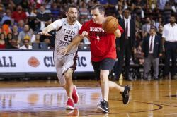 Senator Ted Cruz dribbles past Jimmy Kimmel during the Blobfish Basketball Classic and one-on-one interview at Texas Southern University's Health & Physical Education Arena.