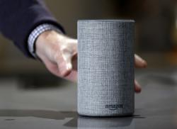 In this Sept. 27, 2017, file photo, a new Amazon Echo is displayed during a program announcing several new Amazon products by the company, in Seattle