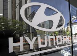 In this Wednesday, April 26, 2017, file photo, the logo of Hyundai Motor Co. is displayed at the automaker's showroom in Seoul, South Korea