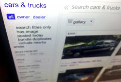 This photo shows listings for cars and trucks for sale on a website Tuesday, June 19, 2018, in New York