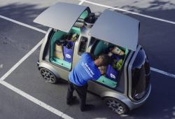 This undated photo provided by The Kroger Co. shows a driverless car that the Cincinnati-based company is about to test whether it can steer supermarket customers away from crowded grocery aisles with a fleet of diminutive driverless cars designed to lower delivery costs.