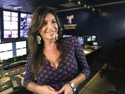 This April 30, 2018, photo provided by Telemundo Deportes shows Viviana Vila posed at Telemundo Desportes Studios in Miami.