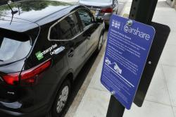In this June 1, 2018 photo, an Enterprise CarShare vehicle occupies a parking space in one of the new designated Carshare areas, on New York's Upper West Side