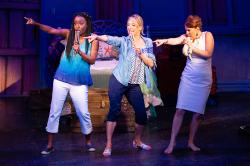 "Tari Kelly, Erica Mansfield and Jeanette Bayardelle in ""Mamma Mia!"" at Theatre by the Sea through July 21."