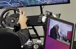 In this April 23, 2018, photo, Ashley McManus, global marketing director of the Boston-based artificial intelligence firm, Affectiva, demonstrates facial recognition technology that is geared to help detect driver distraction, at their offices in Boston
