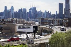 Traffic spirals up-and-down a section of Route 495 to the Lincoln Tunnel, in Weehauken, N.J., with the New York City skyline in the background.