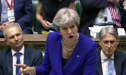 Britain's Prime Minister Theresa May speaks during Prime Minister's Questions in the House of Commons, London, Wednesday July 4, 2018