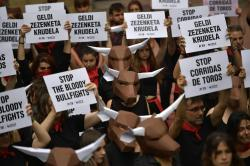 Demonstrators protest against bullfighting in front of the City Hall a day before of the famous San Fermin festival, in Pamplona, northern Spain, Thursday, July 5, 2018.