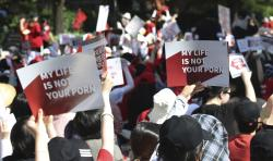 Woman protesters stage a rally to demand stronger government action to fight the spread of intimate photos and footage taken by hidden cameras.