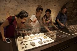 "In this Wednesday, June 27, 2018 photo, visitors look at exhibits, entitled ""The House of Herod: Life and Power in the Age of the New Testament,"" at the Terra Sancta Museum in Jerusalem"