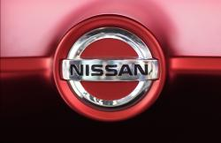 This June 14, 2018, file photo, shows a Nissan logo on a Nissan Concept 2020 Vision Gran Truismo on display at the automaker's showroom in Tokyo