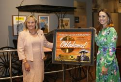 "Oklahoma Gov. Mary Fallin, left, stands with Cara Duckworth, right, of the Recording Industry Association of America (RIAA), the organization which administers the Gold and Platinum Awards Program, and a commemorative plaque honoring the ""Oklahoma!"" film soundtrack and its place in music history, in Oklahoma City."