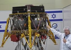 "Opher Doron, general manager of Israel Aerospace Industries' space division, speaks beside the SpaceIL lunar module, in a special ""clean room"" where the space craft is being developed, during a press tour of their facility near Tel Aviv, Israel, Tuesday, July 10, 2018"