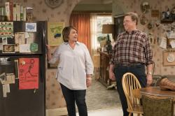"Roseanne Barr, left, and John Goodman in a scene from the comedy series ""Roseanne."""