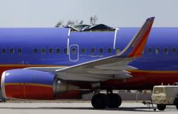 A Southwest Airlines plane sits in a remote area of the Yuma International Airport.