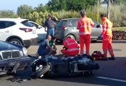 Ambulance personnel tend to a man lying on the ground, later identified as actor George Clooney, after being involved in a scooter accident in the near Olbia, on the Sardinia island, Italy.