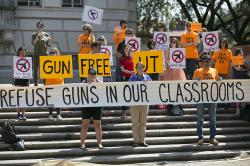 In this Oct. 1, 2015, file photo, protesters gather on the West Mall of the University of Texas campus, in Austin, to oppose a new state law that expands the rights of concealed handgun license holders to carry their weapons on public college campuses and as of Aug. 1, 2016, they can carry in campus buildings.