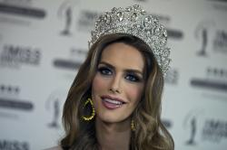 Angela Ponce, who won Spain's Miss Universe competition in June, speaks during an interview with The Associated Press in Madrid, Spain.