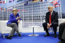 President Donald Trump meets with German Chancellor Angela Merkel during their bilateral meeting at the NATO Summit in Brussels, Belgium, Wednesday, July, 11, 2018
