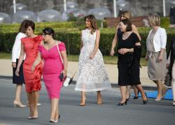 First lady Melania Trump, center, arrives with other first ladies during a group photo of NATO heads of state and government at Park Cinquantenaire in Brussels, Belgium.